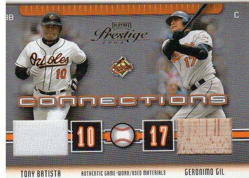 Photo of 2003 Playoff Prestige Connections Materials #8 Tony Batista Jsy/Geronimo Gil Bat