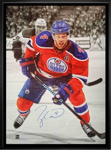 Taylor Hall - Signed & Framed 20x29 Edmonton Oilers Orange Action Canvas