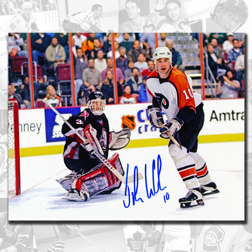 John LeClair Philadelphia Flyers vs. Hasek Autographed 8x10