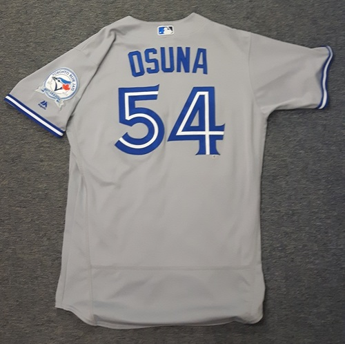 Photo of Authenticated Game Used Jersey - #54 Roberto Osuna (April 3, 2016: Opening Day 2016). Osuna went 1 IP with 1 Hit, 0 ER and 2 Ks. Recorded Save #1 on the Season.