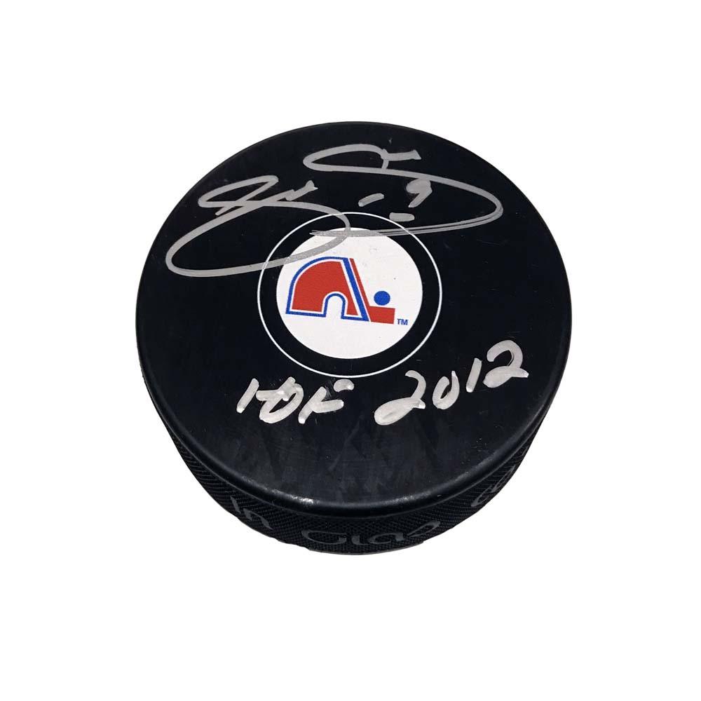 JOE SAKIC Signed Quebec Nordiques Puck with HOF 2012 Inscription