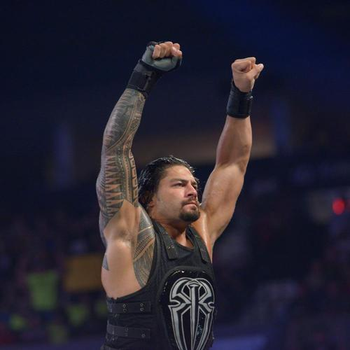 Photo of Roman Reigns WORN & SIGNED Glove & Wristband Set (Smackdown - 08/11/15)