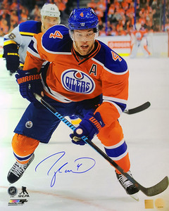 Taylor Hall - Signed 16x20 Edmonton Oilers Orange Action Photo