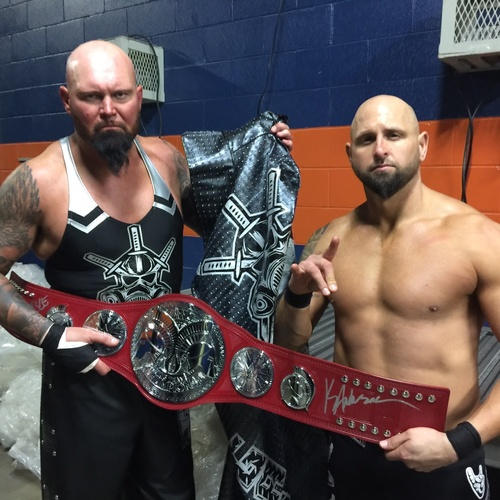 Photo of Gallows & Anderson SIGNED WWE RAW Tag Team Championship Replica Title (Royal Rumble - 01/29/17)