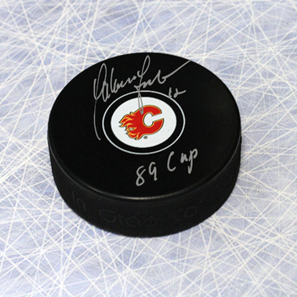 Hakan Loob Calgary Flames Autographed Hockey Puck w/ 1989 Cup Note