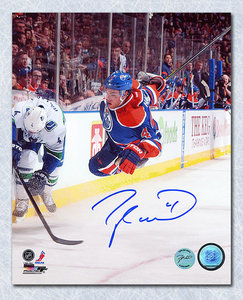 Taylor Hall Edmonton Oilers Autographed Airborn Action 8x10 Photo
