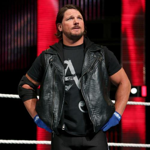 Photo of AJ Styles WORN & SIGNED T-Shirt (RAW - 02/22/16)
