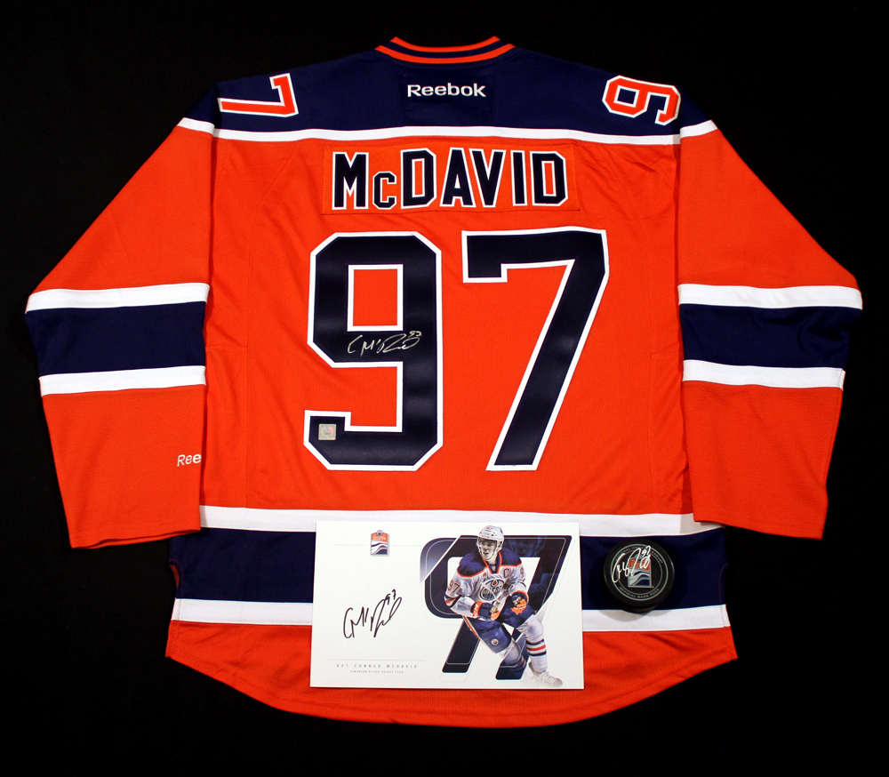 Connor McDavid #97 - Ultimate Fan Autographed Memorabilia Collection Including Orange Replica Jersey, Player Card & New Game Puck!