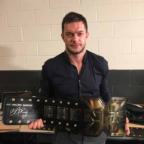 Photo of Finn Balor SIGNED NXT Championship Replica Title (NXT TakeOver: Brooklyn - 8/22/15)