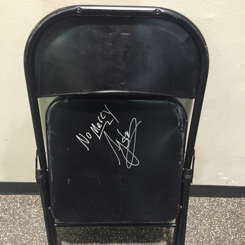 Photo of AJ Styles USED & SIGNED Steel Chair (No Mercy -10/09/16)