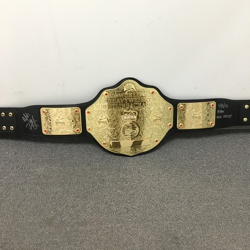 Photo of Dolph Ziggler SIGNED World Heavyweight Championship Replica Title