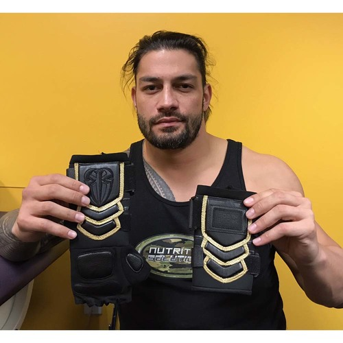 Photo of Roman Reigns WORN & SIGNED Glove & Wristband Set (No Mercy - 09/24/17)