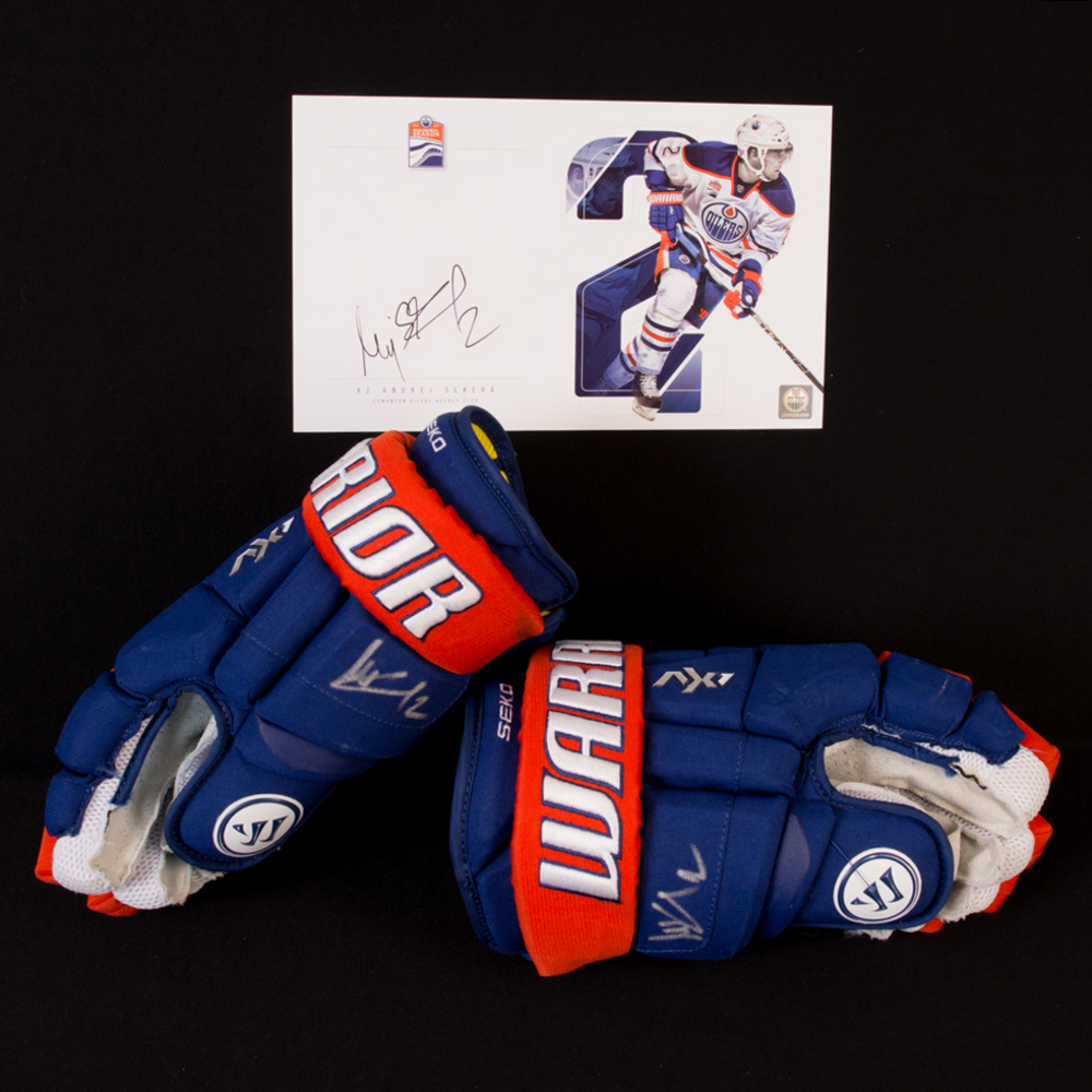 Andrej Sekera #2 - Autographed 2016-17 Edmonton Oilers Game-Worn Warrior Hockey Gloves - Includes Autographed Oversize Player Card!
