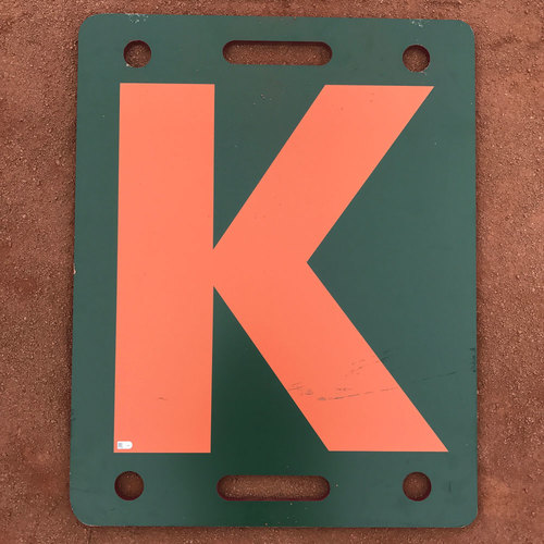 "Photo of San Francisco Giants - K Board - 2017 Orange ""K"" - Madison Bumgarner strikes out Javier Baez"
