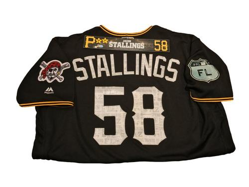 Photo of Jacob Stallings Team-Issued Spring Training Jersey and Game-Used Locker Name Plate