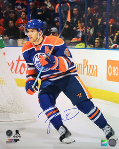 Taylor Hall - Signed 16x20 Edmonton Oilers Blue Action Photo
