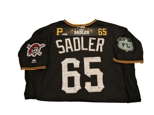 Photo of Casey Sadler Team-Issued Spring Training Jersey and Game-Used Locker Name Plate