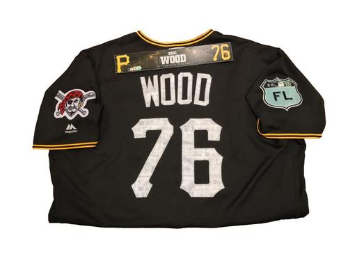 Photo of Eric Wood Team-Issued Spring Training Jersey and Game-Used Locker Name Plate