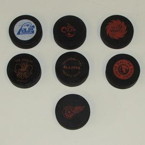 Lot of Seven Classic Minor League Official Game Pucks - AHL, CHL & CPHL