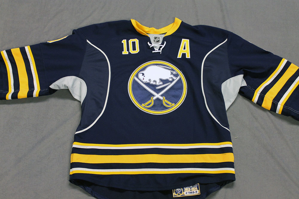 Christian Ehrhoff Game Worn Buffalo Sabres Home Jersey.  Serial: 1163-2. Set 2 - Size 56.  2013-14 season.