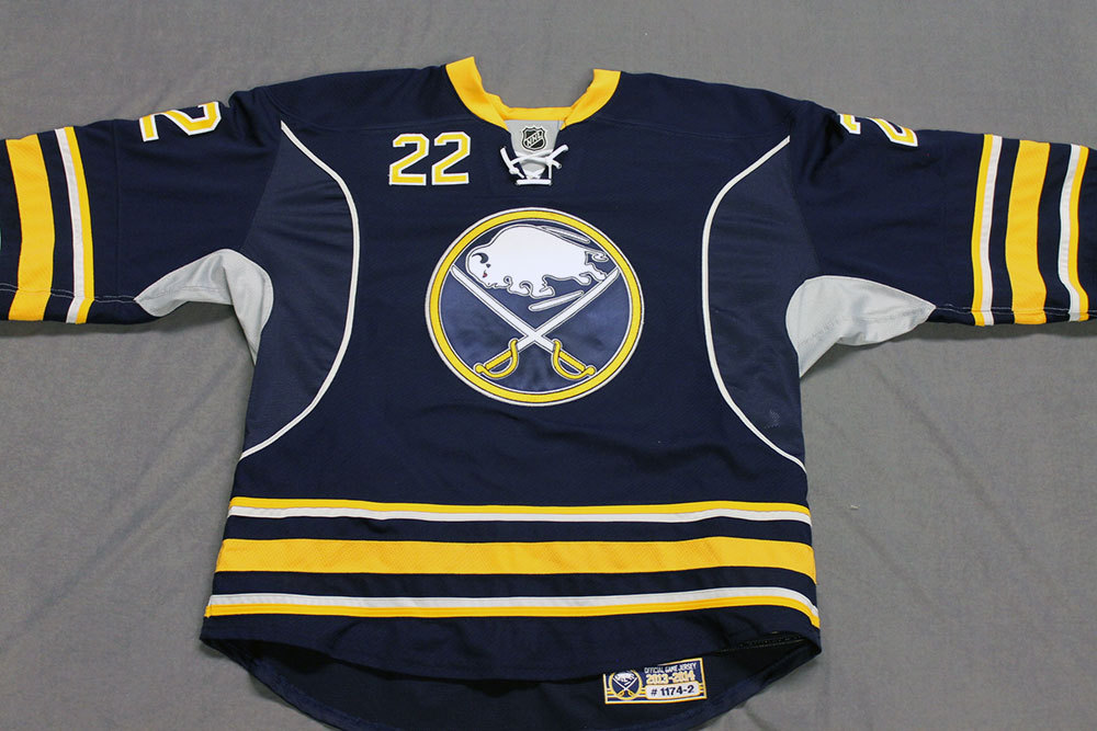 Johan Larsson Game Worn Buffalo Sabres Home Jersey.  Serial: 1174-2. Set 2 - Size 56.  2013-14 season.