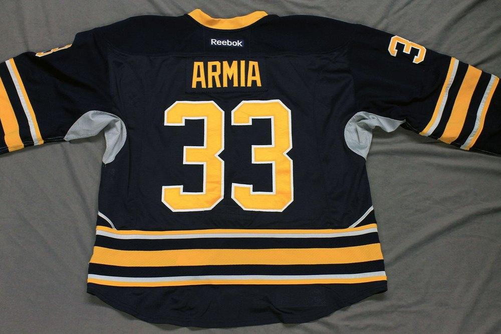 Joel Armia Game Worn Buffalo Sabres Home Jersey.  Serial: 1018-1. Set 1 - Size 56.  2013-14 season.