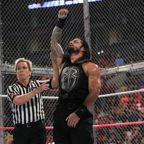 Photo of Roman Reigns WORN & SIGNED Glove & Wristband Set (Hell in a Cell - 10/25/15)