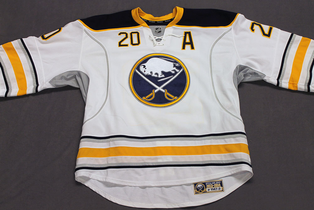 Henrik Tallinder Game Worn Buffalo Sabres Away Jersey.  Serial: 1147-2. Set 2 - Size 58.  2013-14 season.