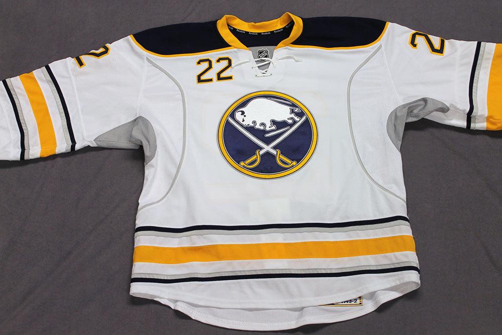Johan LarssonGame Worn Buffalo Sabres Away Jersey.  Serial: 1143-2. Set 2 - Size 56.  2013-14 season.