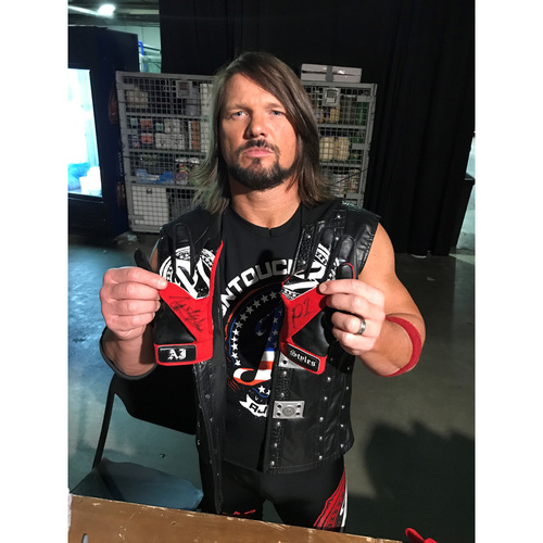 Photo of AJ Styles WORN & SIGNED Gloves (SmackDown - 08/15/17)