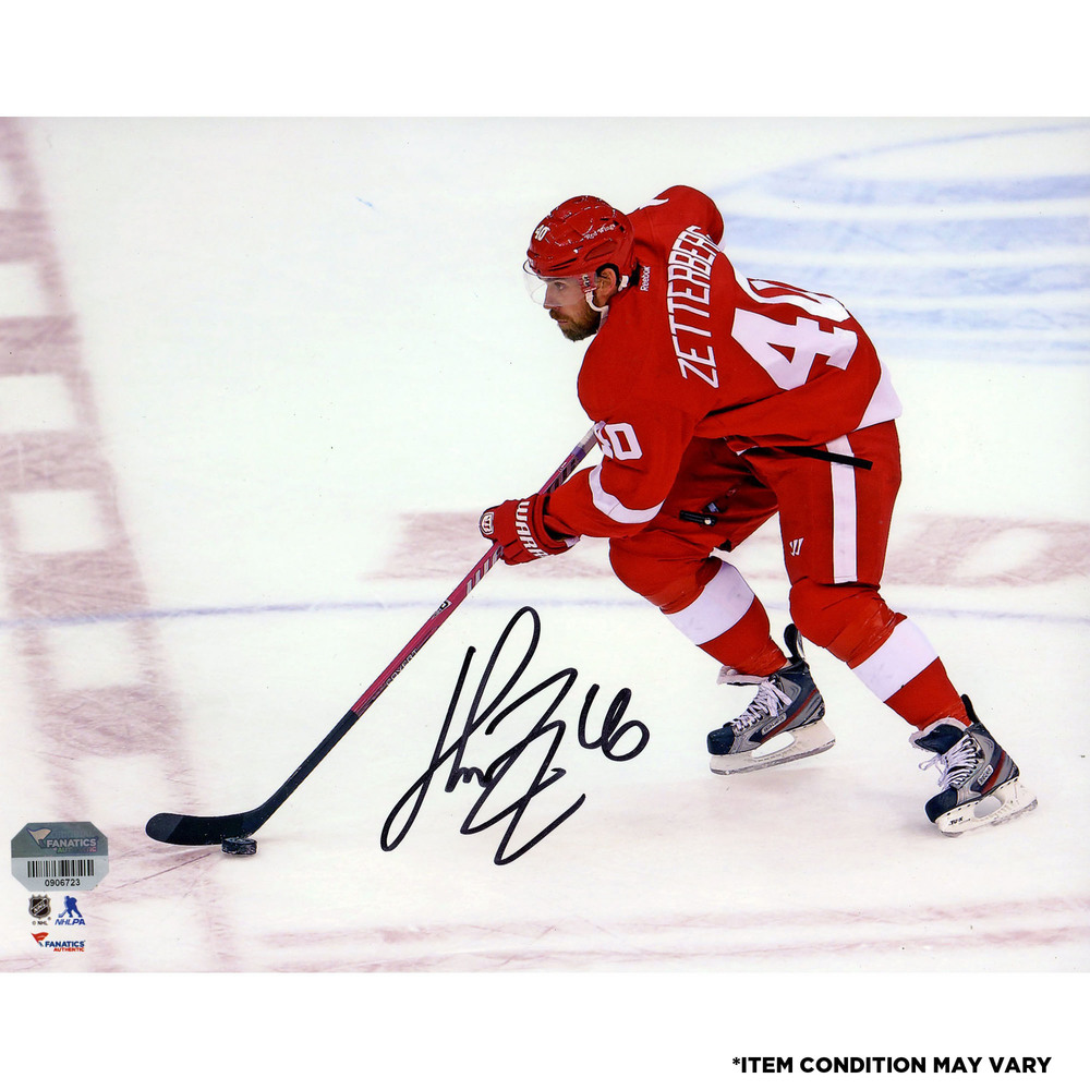 Henrik Zetterberg Detroit Red Wings Autographed Skating With Puck 8
