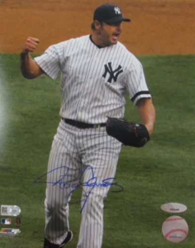 Roger Clemens Autographed 16x20 Photograph (Yankees Celebration)