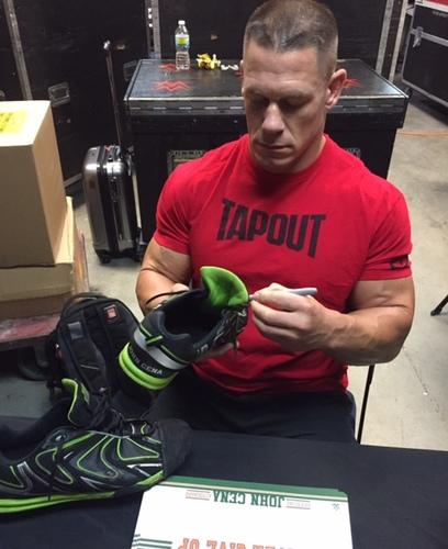 Photo of John Cena WORN & SIGNED Sneakers