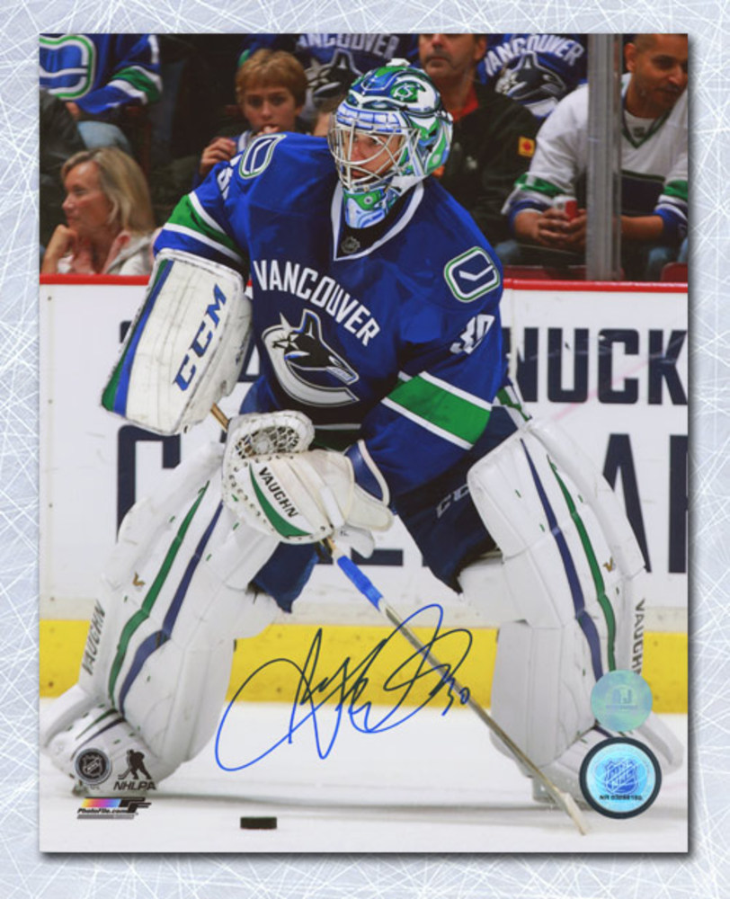 Ryan Miller Vancouver Canucks Autographed Passing the Puck 8x10 Photo *Anaheim Ducks*