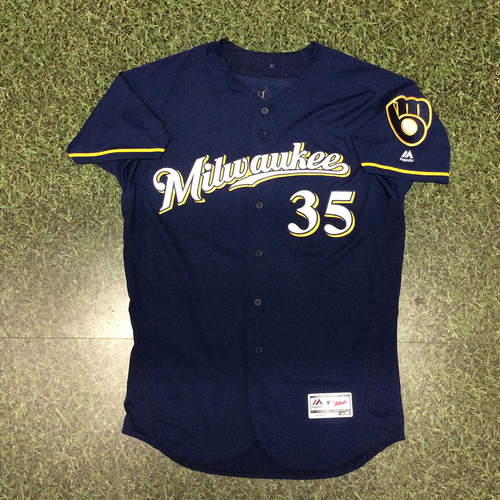 Photo of Brent Suter 09/23/17 Game-Used Navy Ball&Glove Jersey - 5.1 IP, 1 ER, 2 SO, No Decision