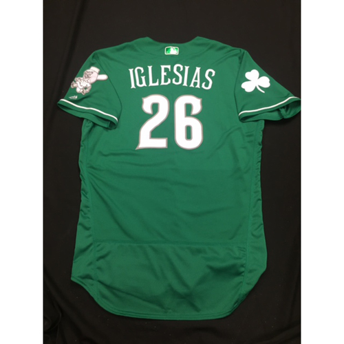 Photo of Raisel Iglesias-- Game-Used -- Irish Heritage Jersey -- Worn for Bronson Arroyo Farewell Game -- Red Sox vs. Reds -- 9/23/17