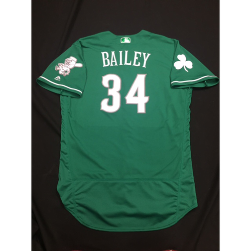Photo of Homer Bailey -- Game-Used -- Irish Heritage Jersey -- Worn for Bronson Arroyo Farewell Game -- Red Sox vs. Reds -- 9/23/17
