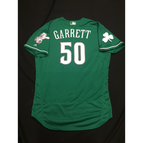 Photo of Amir Garrett -- Game-Used -- Irish Heritage Jersey -- Worn for Bronson Arroyo Farewell Game -- Red Sox vs. Reds -- 9/23/17
