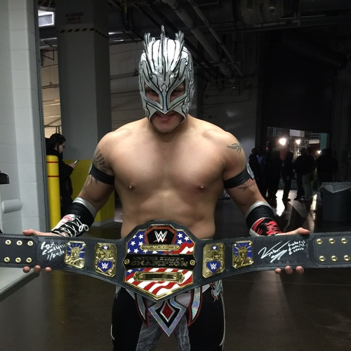 Photo of Kalisto SIGNED WWE United States Championship Replica Title ( Royal Rumble - 01/24/16)