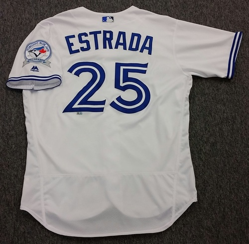Photo of Authenticated Game-Used #25 Marco Estrada Home Jersey - worn Sept 9, 2016 vs Boston Red Sox. Estrada went 2.1IP, 6H, 4R, 3ER, 3BB, 2SO