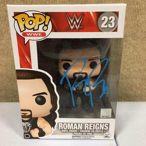 Photo of Roman Reigns SIGNED POP! Vinyl Figure