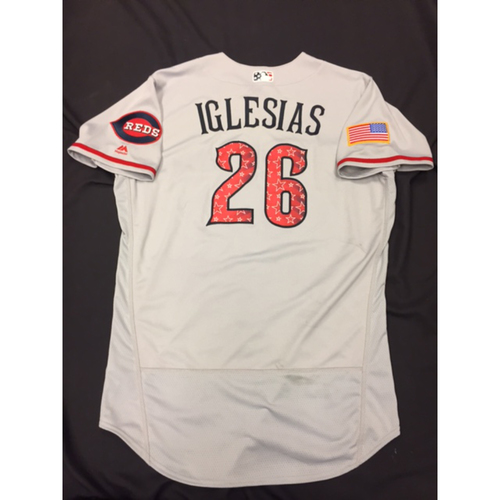 Photo of Raisel Iglesias -- Game-Used Stars & Stripes Road Jersey -- Reds @ Rockies on July 4, 2017
