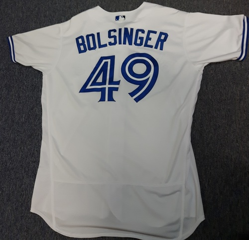 Photo of Authenticated Game Used Jersey - #49 Mike Bolsinger (May 9, 2017: Blue Jays Debut. Started and went 5.2 IP with 2 ER and 4 Ks. Losing Pitcher). Size 48.
