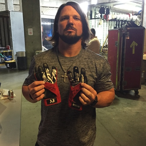 Photo of AJ Styles WORN & SIGNED Gloves (No Mercy - 10/09/16)