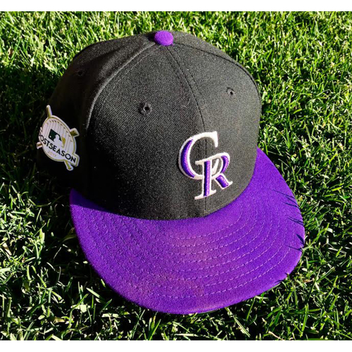 Photo of 2017 National League Comeback Player of the Year Award Winner Greg Holland Game-Used Postseason Cap.