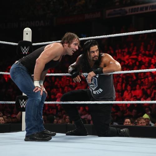 Photo of Roman Reigns WORN & SIGNED Glove & Wristband Set (RAW - 08/10/15)