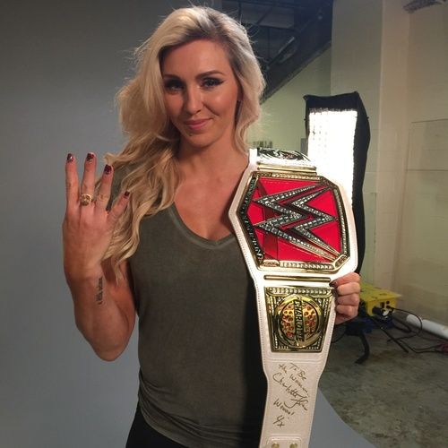 Photo of Charlotte Flair SIGNED WWE RAW Women's Championship Replica Title