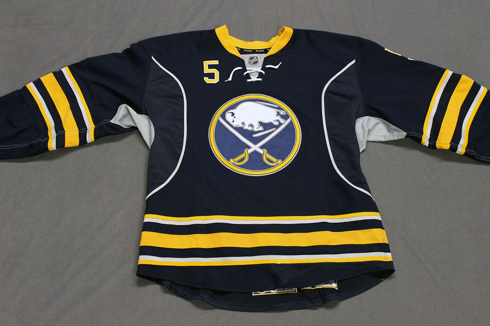 Chad Ruhwedel Game Worn Buffalo Sabres Home Jersey.  Serial: 1051-1. Set 2 - Size 54.  2013-14 season.