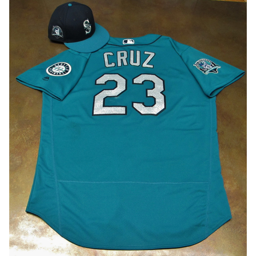 Photo of Nelson Cruz Green Game-Used Jersey & Cap With Edgar Martinez Patch Worn 8-11-2017