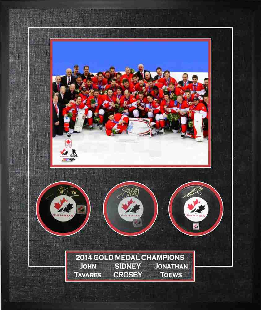 Crosby/Toews/Tavares Signed Framed Pucks 2014 Team Canada Celebration